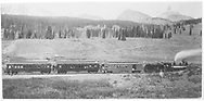"""RGS #12 with train returning from """"Silver Spike"""" celebration in Rico with Lizard Head Peak on skyline.  The coach-baggage is either #200 or #201; the coaches are of the #250-#253 series.<br /> RGS  Snow, CO  Taken by Carpenter, W. J. - 10/15/1891<br /> In book """"RGS Story, The Vol. IV: Over the Bridges? Ophir Loop to Rico"""" page 338<br /> Also at RD137-069.  Also in """"Silver San Juan"""", pp. 114-115; Galloping Geese on the RGS"""", p. 34; """"CRA #9"""", p. 34; """"Galloping Geese on the RGS"""", p. 34 and """"CRA #25"""", p. 317."""
