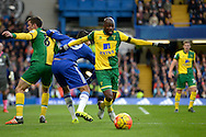 Youssuf Mulumbu of Norwich City goes past Diego Costa of Chelsea. Barclays Premier league match, Chelsea v Norwich city at Stamford Bridge in London on Saturday 21st November 2015.<br /> pic by John Patrick Fletcher, Andrew Orchard sports photography.