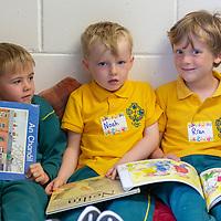 Noah Mac Conchra, Ruadhán Ó Catháin and Daithi O Maoidomhnaigh in the reading corner on their first day of school at Gaelscoil Mhíchíl Cíosóg, Inis