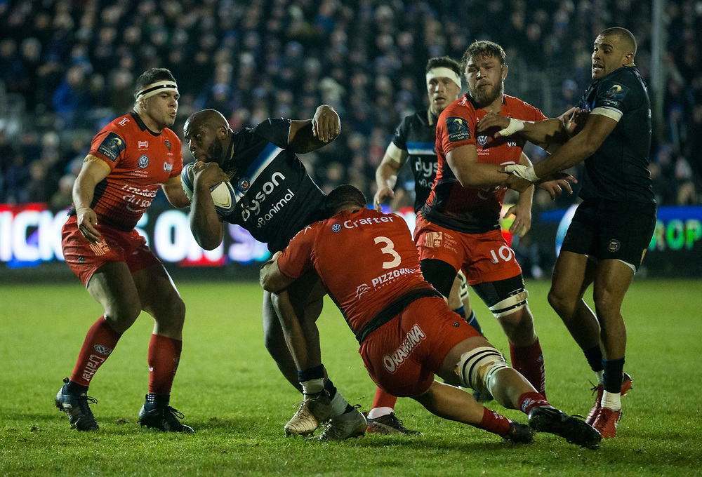 Bath Rugby's Beno Obano is tackled by Toulon's Marcel Van der Merwe<br /> <br /> Photographer Bob Bradford/CameraSport<br /> <br /> European Rugby Champions Cup Pool 5 - Bath Rugby v Toulon - Saturday 16th December 2017 - The Recreation Ground - Bath<br /> <br /> World Copyright © 2017 CameraSport. All rights reserved. 43 Linden Ave. Countesthorpe. Leicester. England. LE8 5PG - Tel: +44 (0) 116 277 4147 - admin@camerasport.com - www.camerasport.com