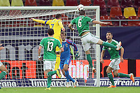 ROMANIA, Bucharest : Romania's Alexandru Chipciu (L) and Northern Ireland's Chris Baird (R) vie for the ball during the Euro 2016 Group F qualifying football match Romania vs Northern Ireland in Bucharest, Romania on November 14, 2014.