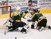 Victoria Grizzlies forward Tyler Welsh watches as he pass goes through the crease and past Power River goaltender Brian Wilson at the Q Centre in Colwood, British Columbia Canada on March 27, 2017.