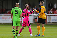 Forest Green Rovers Sam Russell(23) shakes the hand of former Forest Green and Dovers goalkeeper Steve Arnold at the end of the game the Vanarama National League match between Dover Athletic and Forest Green Rovers at Crabble Athletic Ground, Dover, United Kingdom on 10 September 2016. Photo by Shane Healey.