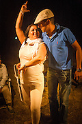 """In the days before the procession of the Virgin through the streets of El RocÌo, brotherhoods celebrate the pilgrimage in a camp in the middle of the night, musicians and singers assembled """"jaleo"""" until dawn, like these improvised flamenco dances that emerge without being previously planned."""