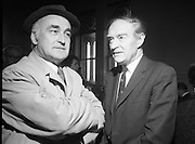 Mr Liam Cosgrave,Leader of Fine Gael,at Vote Count. (E48)1973..01.03.1971..03.01.1973..1st March 1973..As the ballot boxes were opened in Dun Laoghaire Town Hall, Mr Cosgrave and his supporters watched as the voting papers were piled high. The vote was as the result of an often hectic General Election campaign. Mr Cosgrave was hoping his party would garner enough votes to oust the sitting Fianna Fail Government which had held power for sixteen years...Picture of a pensive Liam Cosgrave,Leader of Fine Gael, and one of his supporters as he contemplates his result and how the rest of the general election voting is proceeding for his party.