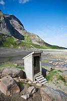 Wood drop toilet at Bunes beach, Moskenesoy, Lofoten islands, Norway.