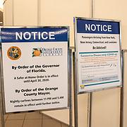 Passenger arrival signs showing advisories due to Coronavirus (Covid-19) are seen at Orlando International Airport on Friday, April 17, 2020 in Orlando, Florida. (Alex Menendez via AP)