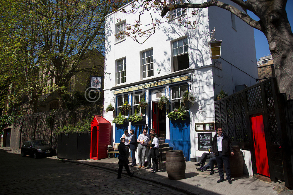 The Grenadier pub in Belgravia. It was originally built in 1720 as the officers' mess for the senior infantry regiment of the British army, so was located in a courtyard of their barracks. It was opened to the public in 1818 as The Guardsman and was subsequently renamed in honour of the Grenadier Guards. In a selected few boroughs of West London, wealth has changed over the last couple of decades. Traditionally wealthy parts of town, have developed into new affluent playgrounds of the super rich. With influxes of foreign money in particular from the Middle-East. The UK capital is home to more multimillionaires than any other city in the world according to recent figures. Boasting a staggering 4,224 'ultra-high net worth' residents - people with a net worth of more than $30million, or £19.2million.. London, England, UK.