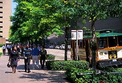 Stock photo of pedestrians walking down the sidewalk in downtown Houston Texas