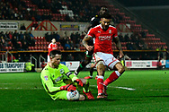 Sid Nelson (25) of Yeovil Town claims the ball before Kaiyne Woolery (22) of Swindon Town can get to it during the EFL Sky Bet League 2 match between Swindon Town and Yeovil Town at the County Ground, Swindon, England on 10 April 2018. Picture by Graham Hunt.