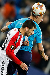 November 23, 2017 - Saint Petersburg, Russia - Emiliano Rigoni of FC Zenit Saint Petersburg and Besir Demiri (in front) of FK Vardar vie for a header during the UEFA Europa League Group L match between FC Zenit St. Petersburg and FK Vardar at Saint Petersburg Stadium on November 23, 2017 in Saint Petersburg, Russia. (Credit Image: © Mike Kireev/NurPhoto via ZUMA Press)