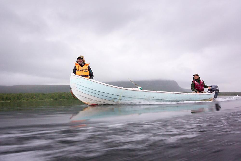 16 July 2017, Tjuonajokk, Lapland, Sweden: Flyfishers Kajsa (left) and Mattias (right) on the way to the water in Tjuonajokk.