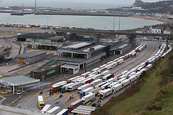 © Licensed to London News Pictures 26/12/2020.        Dover, UK. Queuing lorries at the Port of Dover late this afternoon. Over 1000 lorries are left queuing on the M20 heading for Dover as Manston Airport is cleared. Emergency services and military personnel continue to tests travellers at Dover in Kent for Coronavirus before they cross the English Channel. Photo credit:Grant Falvey/LNP