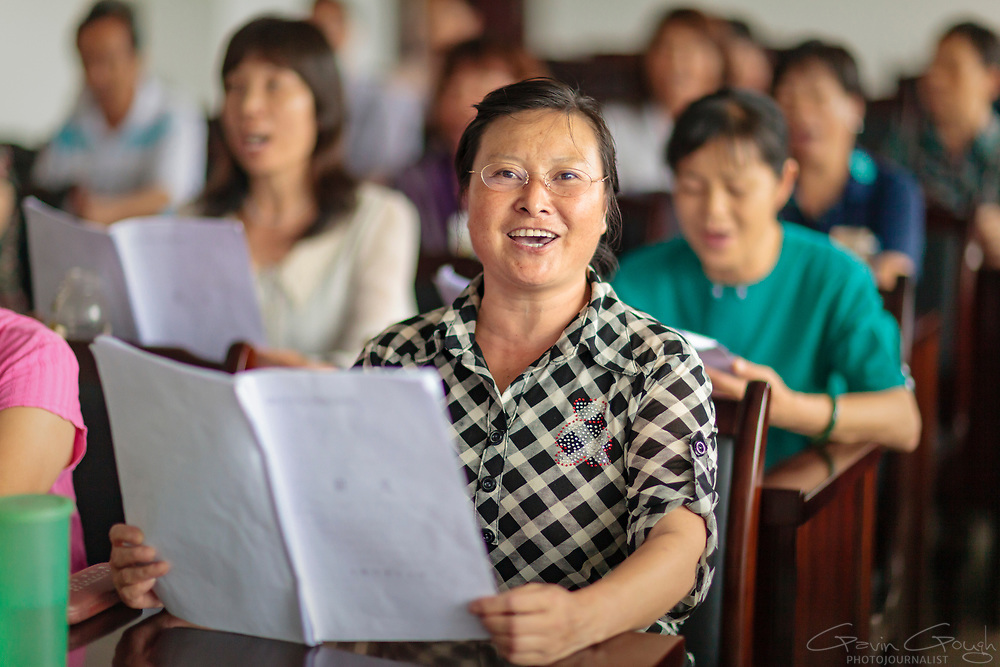 A woman singing during a rehearsal at a University of the Third Age (U3A). Older citizens can take advantage of any one of dozens of different classes.