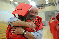 Wellesley High School teacher and sailing coach Larry Lovett gets a hug from Estella Brenneman before the class of 2016 graduation ceremony, June 3, 2016.<br /> Wicked Local staff photo / Kate Flock