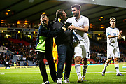 Security catches the Russian fan who ran on to the field at the end of the UEFA European 2020 Qualifier match between Scotland and Russia at Hampden Park, Glasgow, United Kingdom on 6 September 2019 but Georgy Dzhikiya of Russia (14) (Zenit St Petersburg) gives him his shirt and helps guide him off the pitch.