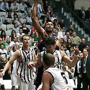 Besiktas's Brad NEWLEY (L) and Efes Pilsen's Charles SMITH (C) during their Turkish Basketball league Play Off semi final second leg match Besiktas between Efes Pilsen at the BJK Akatlar Arena in Istanbul Turkey on Wednesday 12 May 2010. Photo by Aykut AKICI/TURKPIX