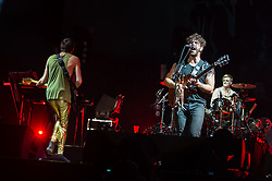 © Licensed to London News Pictures. 06/09/2014. Isle of Wight, UK. Foals performing live at Bestival 2014 Day 3 Saturday. In this picture  Jimmy Smith (left), Yannis Philippakis (centre), Jack Bevan (right)  Foals are an English indie rock band from consisting of members Yannis Philippakis (lead vocals, lead guitar,drums), Jack Bevan (drums), Jimmy Smith (rhythm guitar), Walter Gervers (bass), Edwin Congreave (keyboards).  This weekend's headliners include Chic featuring Nile Rodgers, Foals and Outcast.   Bestival is a four-day music festival held at the Robin Hill country park on the Isle of Wight, England. It has been held annually in late summer since 2004.    Photo credit : Richard Isaac/LNP