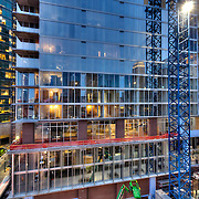 Construction progress on One Light Tower in downtown Kansas City, Missouri in March 2015. Residential tower construction at 13th & Walnut, co-developed by Cordish Company and Kushner Companies, construction by general contractor JE Dunn. Humphreys & Partners Architects.