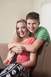 Teenage couple relaxing on couch