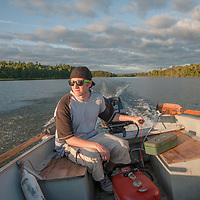 Ben Wiltsie drives an outboard powered boat on Lake of the Woods, near Kenora, Ontario, Canada.