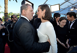 Harvey Weinstein, Marion Cotillard arriving for the Immigrant screening held at the Palais Des Festivals in Cannes, France on May 24, 2013, as part of the 66th Cannes Film Festival. Photo by Lionel Hahn/ABACAPRESS.COM  | 366103_028