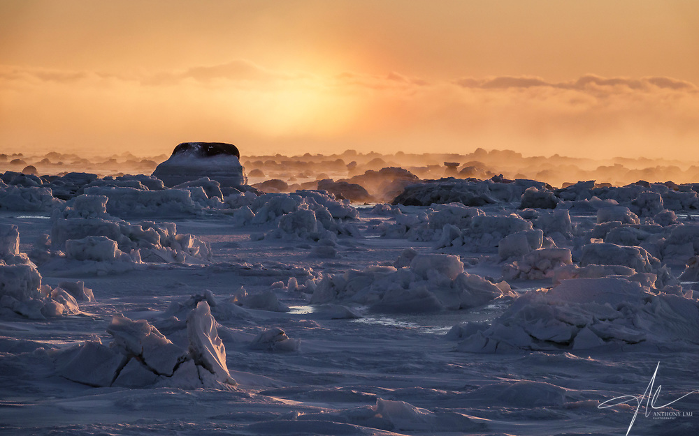 Wonderful moment at -30c in the coast of Hudson Bay in Churchill, Manitoba of Canada.<br /> <br /> Morning sun vaporized the snow, and when the frozen coast was covered by ice mist, a sun dog appeared over the horizon due to reflection of sun light.