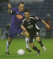 Photo: Dave Howarth.<br />Stockport County v Swansea City. The FA Cup.<br />05/11/2005.  Swansea's Leon Britton (R) beats Stockport's Matther Hamshaw to the ball