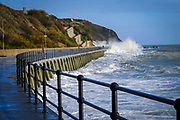 Waves crashing over the walkway down to Sunny Sunny Sands Beach on 8th December 2018 in Folkestone, Kent, United Kingdom. The tide is high covering all the beach and the sea is rough from stormy weather.