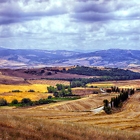 Pienza. Tuscany. Italy. View of the rolling dreamy and romantic Tuscan landscapes of the Val d'orcia that surround the charming Renaissance and medieval hilltop town of Pienza in southern Tuscany.