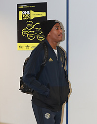 Anthony Martial of Manchester United is spotted on his way to catch a flight as the team fly to Turin on Tuesday afternoon to play Juventus in The Champions League on Wednesday night.