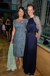 Left to right, actress JULIET AUBREY and BRITA FERNANDEZ SCHMIDT at The Women for Women International & De Beers Summer Evening held at The Royal Opera House, Covent Garden, London on 23rd June 2014.