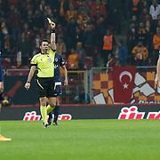 Referee's Rifat Aydinus yellow card during their Turkish Super League soccer match Galatasaray between Mersin idman Yurdu at the AliSamiYen Spor Kompleksi TT Arena at Seyrantepe in Istanbul Turkey on Saturday, 20 December 2014. Photo by Aykut AKICI/TURKPIX