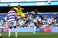 Kemar Roofe of Leeds United heads and goes close to scoring from a cross. Skybet EFL championship match, Queens Park Rangers v Leeds United at Loftus Road Stadium in London on Sunday 7th August 2016.<br /> pic by John Patrick Fletcher, Andrew Orchard sports photography.
