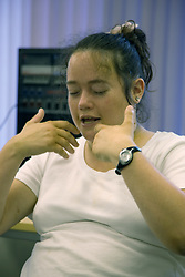 Day Service user with learning disability using makaton whilst singing,