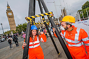 Anti-Fracking protesters target HSBC in global day of action. Mock Drill Rig, 'fracked water', hazard tape and speakers from affected communities turn two Central London HSBCs are turned into 'live fracking sites' in protest about funding to fracking. 'Global Frackdown' day of action sees 100s of actions against fracking in over 30 countries.Parliament Square, London. 11 Oct 2014.Guy Bell, 07771 786236, guy@gbphotos.com