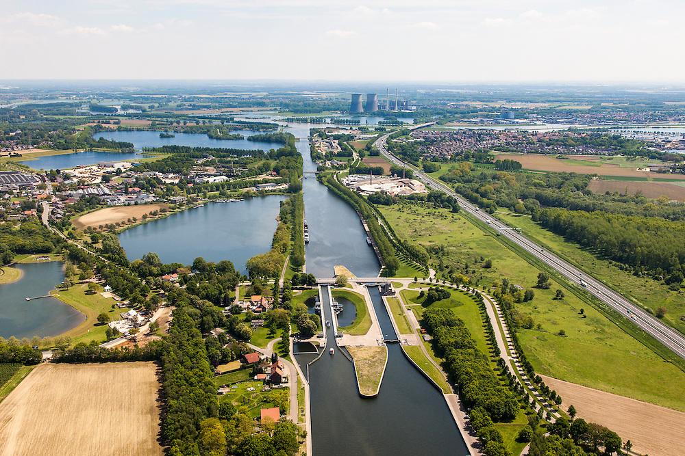 Nederland, Limburg, Gemeente Maasgouw, 27-05-2013; sluis Panheel, kanaal Wessem-Nederweert. Maasbracht en Prins Clauscentrale in de achtergrond.<br /> De sluis is voorzien van spaarbekkens (om bij het schutten water te besparen bij lage waterstanden van de Maas).<br /> Shipping lock Panheel, canal Wessem-Nederweert. The lock is equipped with reservoirs to save water at low water levels of the river Meuse.<br /> luchtfoto (toeslag op standaardtarieven);<br /> aerial photo (additional fee required);<br /> copyright foto/photo Siebe Swart.