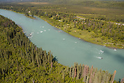 Views of the Kenai River taken from a helicopter at 300ft. over the famous Kenai River.  Salmon dipnetting, rod and reel sport fishing, commercial and sport fishing boats can be seen from the air as well as river infastructure, ie: canneries, boat launches, boardwalks, and the Cities of Kenai and Soldotna surrounding the wild and salmon filled river paradise.