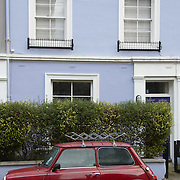 Red Mini Mayfair and pale blue house in Notting Hill, London