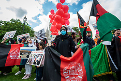 © Licensed to London News Pictures. 18/08/2021. LONDON, UK.  Members of the British Afghan community protest in Parliament Square in reaction to the Taliban takeover of Afghanistan.  Parliament has been recalled early for Boris Johnson, Prime Minister, and MPs to debate the UK government's decision to bring 20,000 vulnerable Afghan refugees, particularly women and children, to the country..  Photo credit: Stephen Chung/LNP