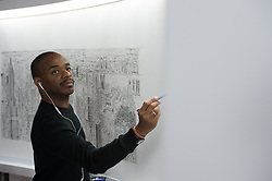 October 13, 2017 - New York, New York, U.S - Renowned artist STEPHEN WILTSHIRE continues drawing the Empire State Building and New York City from memory at the Empire State Building on October 13, 2017 in New York. Following a 45-minute helicopter ride around Manhattan, Wiltshire will draw a cityscape beginning today through Sunday, October 15, 2017, culminating with a signing ceremony on Monday, October 16, 2017.  Wiltshire famously creates his artwork from memory and will do this piece in residence on the 80th floor of the Empire State Building. The London-based artist's progress will be visible to Observatory visitors as he draws from 10 a.m. to 5 p.m. daily. (Credit Image: © Bryan Smith via ZUMA Wire)