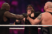 Shaquille O'Neal and The Big Show choke Kane during a 20-man battle royal during WrestleMania on April 3, 2016 in Arlington, Texas.