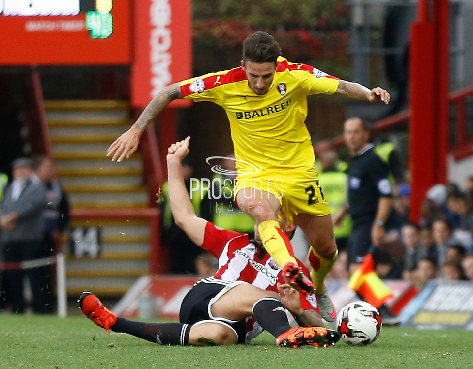 Brentford defender Harlee Dean wins the ball with a great challenge in on Rotherham United striker Matt Derbyshire during the Sky Bet Championship match between Brentford and Rotherham United at Griffin Park, London, England on 17 October 2015. Photo by Andy Walter.