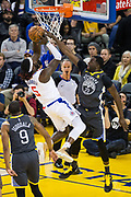 Golden State Warriors forward Draymond Green (23) blocks a shot by LA Clippers forward Montrezl Harrell (5) at Oracle Arena in Oakland, California, on February 22, 2018. (Stan Olszewski/Special to S.F. Examiner)