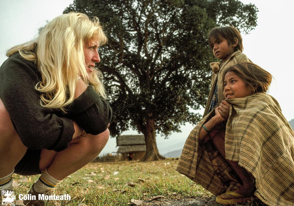 Trekking leader Judy Pyne (Tenzing) talks to brother and sister, Tumlingtar, Arun Valley, Nepal Himalaya