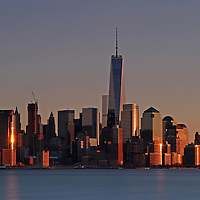 New York City skyline photography image of the FIDI, short for the finanacial district, in downtown New York photographed on a beautiful winter evening minutes before sunset. The New York City World Trade Center is a complex of buildings in Lower Manhattan. The skyscraper is replacing an earlier complex of 7 buildings with the same name on the same site. The original World Trade Center featured landmark twin tower, were destroyed in a tragic terrorist attack on 11 September 2001. The new site is now a rebuilt with six new skyscrapers with a 911 memorial to those killed in the terrorist attacks. One World Trade Center is the tallest skyscraper in the United States.<br /> <br /> This NYC photo image is available as museum quality photography prints, canvas prints, acrylic prints or metal prints. Prints may be framed and matted to the individual liking and decorating needs: <br /> <br /> http://juergen-roth.artistwebsites.com/featured/new-york-city-skyline-juergen-roth.html<br />  <br /> <br /> Good light and happy photo making!<br /> <br /> My best,<br /> <br /> Juergen<br /> www.RothGalleries.com<br /> @NatureFineArt<br /> https://www.facebook.com/naturefineart
