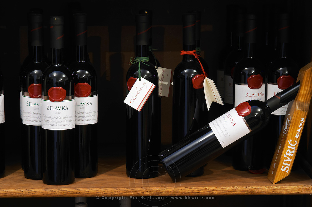 In the winery wine shop, display of various wines from the Vinastojic winery: Zilavka 2003, Chardonnay, Blatina barrique oak aged. Podrum Vinoteka Sivric winery, Citluk, near Mostar. Federation Bosne i Hercegovine. Bosnia Herzegovina, Europe.