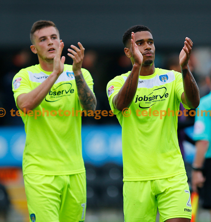 Colchester United's Brennan Dickenson and Richard Brindley salute the away fans during the Sky Bet League 2 match between Barnet and Colchester United at Underhill Stadium in London. September 17, 2016.<br /> Carlton Myrie / Telephoto Images<br /> +44 7967 642437