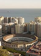 The Plaza de toros La Malagueta bullring, set amongst many apartment blocks, in downtown Malaga, Spain