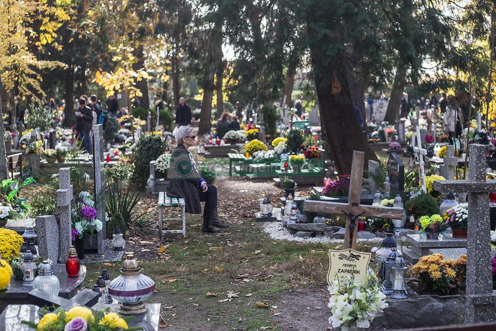 November 1, 2018 - Wroclaw, Poland - Wroclaw, Poland. 1st Nov, 2018. All Saints' Day in Poland - November 1st Polish people visit mass graves of their loved ones.  Credit: Krzysztof Kaniewski/ZUMA (Credit Image: © Krzysztof Kaniewski/ZUMA Wire)